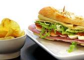 Sandwich with egg ham cheese tomato — Stock Photo