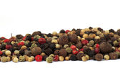 Close up of several types of peppercorns — Stock Photo