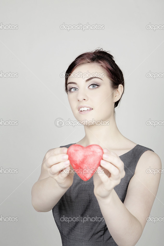 Woman with a love heart shaped symbol tp give to you — Stock Photo #6928691