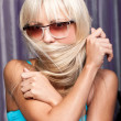 Royalty-Free Stock Photo: Gorgeous blond model in sun glasses