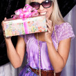 Pretty blond model with a present box — Stock Photo