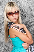 Sexy blond model in stylish sun glasses — Stock Photo