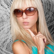 Pretty blond girl in stylish sun glasses — Stock Photo