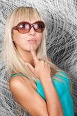 Gorgeous blond model in elegant sun glasses — Stock Photo
