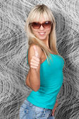 Attractive blond woman in sun glasses — Stock Photo