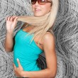 Charming blond girl in elegant sun glasses — Stock Photo
