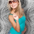 Stylish blond model in elegant sun glasses — Stock Photo