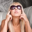 Attractive blond girl in elegant sun glasses — Stock fotografie