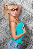 Lovely blond girl in stylish blue shirt and sun glasses — Stock Photo