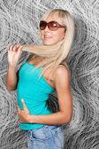 Charming blond girl in elegant sun glasses — Stock Photo