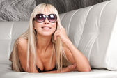 Sexy blond model in stylish sun glasses and black lingerie — Stock Photo
