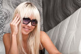 Gorgeous blond model in stylish sun glasses — Stock Photo
