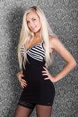 Sensual blond fashion model in sexy black dress — 图库照片