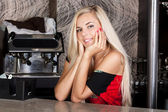Pretty smiling blond woman at bar table — Stock Photo