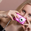 Gorgeous young blond woman with a photo camera — Stock Photo
