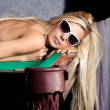 Sensual young blond woman in elegant pink lingerie on a pool table - ストック写真