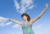 Girl over sky background — Stockfoto