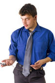 Casual man looking his watch — Stock Photo