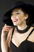 Fashion woman wearing hat — Stockfoto