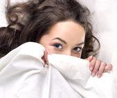 Girl sleeping on the white linen — Stock Photo