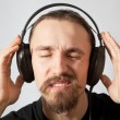 Young man in headphones with eyes closed — Stock Photo
