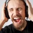 Guy listening to the music and screaming — Stock Photo
