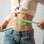 Girl measuring her waist — Stock Photo #6748596