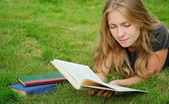 Student reads book — Stock Photo