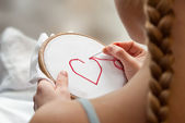 Embroidering girl — Stock Photo