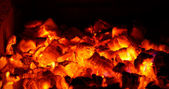 Live coals in fireplace — Stock Photo