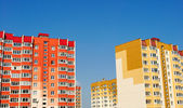Multistory yellow and red houses — Stock Photo