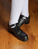 Feet in irish dancing shoes — Stock Photo