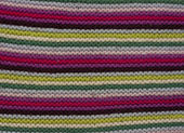 A part of knitted multicolor striped texture. — Stock Photo