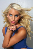 Beautiful Young Blonde Blows a Kiss — Stock Photo