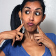 Stock Photo: Beautiful Multiracial Womwith Comical Facial Expression (4)