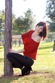 Beautiful Young Woman Leaning on a Tree (3) — Stock Photo