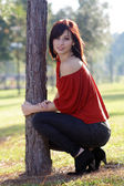 Beautiful Young Woman Leaning on a Tree (4) — Stock Photo