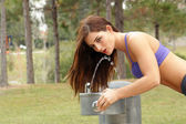Beautiful Brunette Athlete at a Water Fountain (1) — Stock Photo