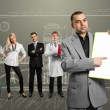 Businessman with empty write board — Stock Photo