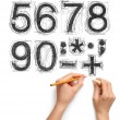 Sketch letters and numbers with hand and pencil — Stock Photo