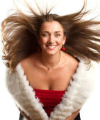 European woman in red dress with furs — Stock Photo