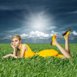 Blonde in yellow dress in green grass — Stock Photo #6927302