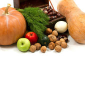Chest with walnuts and pumpkin — Stock Photo