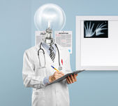 Lamphead doctor writing something — Stock Photo