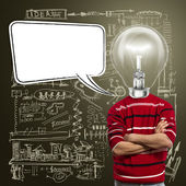 Male in red and lamp-head with speech bubble — Stock Photo