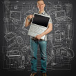 Man with open laptop in his hands — Stock Photo