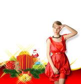 Mujer vestida de rojo con regalos de navidad — Foto de Stock