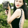 Pretty young woman with a decorative pig, outdoor portrait — Stock Photo #7093033