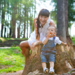 Outdoor portrait of happy mother and son - Stock Photo