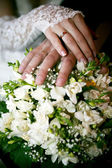 Hands of groom and bride — Stock Photo
